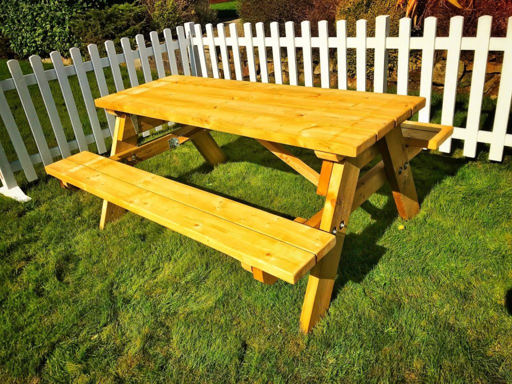 Wooden picnic benches for hire from stage men